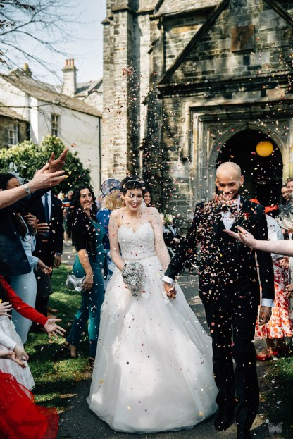 CONFETTI SHOT OUTSIDE OF A CHURCH.